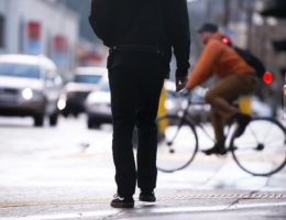 Silhouette-of-pedestrian-on-background-of-other-urban-transport-cm