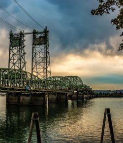 Colorful-Sunset-Over-Columbia-River-Oregon-Washington-Bridge-Dense-Clouds-cm