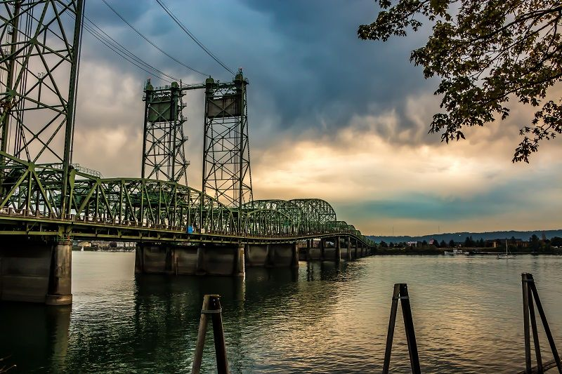 Colorful-Sunset-Over-Columbia-River-Oregon-Washington-Bridge-Dense-Clouds-cm