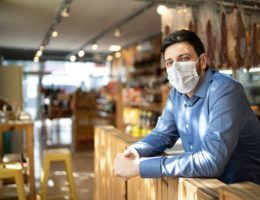 Portrait-of-small-business-man-owner-with-face-mask--cm