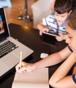 Teenage-girl-studying-with-video-online-lesson-at-home-family-in-isolation-Homeschooling-and-distance-learning--cm