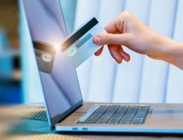 hand-with-the-credit-card-touches-the-laptop-monitor-cm