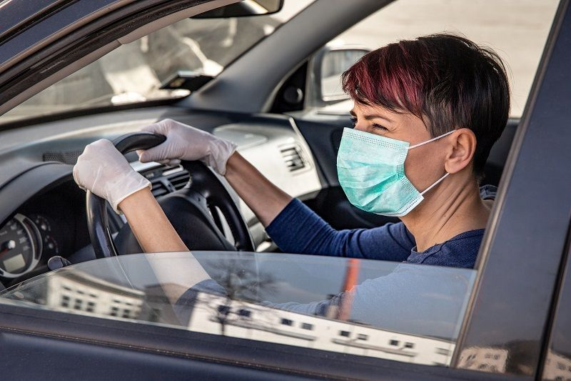 Adult-Woman-Driving-to-Work-Wearing-N95-Face-Mask-and-Surgical-Gloves-During-COVID-19-Outbreak-cm