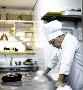 A-worried-senior-chef-in-the-kitchen-counter-cm