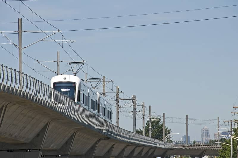 Light rail train northbound on raised track-cm